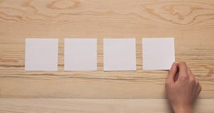 Hand paper wooden background stock images