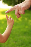 Hand of parent and child in nature Stock Photos