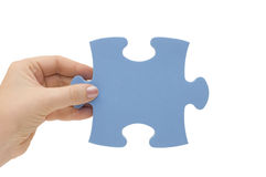 Hand with a part of puzzle Royalty Free Stock Photo
