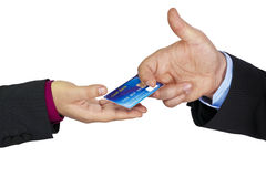 Hand passing a credit card. Foto showing passing of a credit card Isolated on white background royalty free stock image