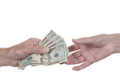 Hand passing dollars to another hand. One hand passing $80 to another hand. White background. Could be honest payment or bribe stock photos