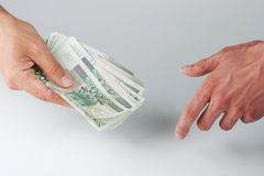 Hand passing money Royalty Free Stock Image