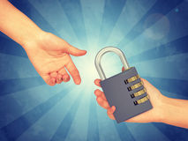 Hand passing pad lock royalty free stock images