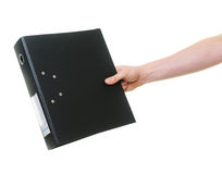 Hand passing ring binder Stock Photos