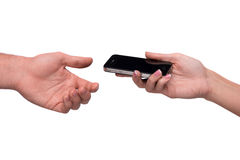Hand passing smart phone Stock Images