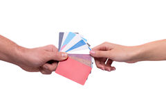 Hand passing visiting cards to other person Stock Photo