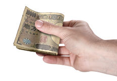 Hand Passing Wad Of Cash Royalty Free Stock Photo