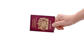 Hand & Passport. An isolated over white caucasian man's hand holding a European Union British passport royalty free stock image