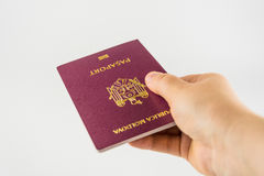 Hand with a passport of a citizen of Moldova Royalty Free Stock Images