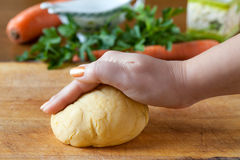 Hand On Pasta Dough On A Cutting Board Royalty Free Stock Photos