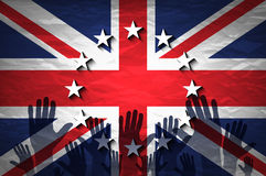 Hand patterned with the flag of the European Community envelops another hand patterned with the flag of the United Kingdom Royalty Free Stock Image