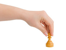 Hand with pawn. Isolated on white background Stock Photography