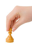 Hand with pawn Stock Image