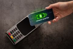 Hand paying with bitcoin. Hand paying with digital currency from smartphonen royalty free stock image