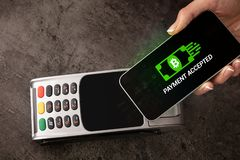 Hand paying with bitcoin. Hand paying with digital currency from smartphonen stock photo