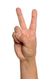 Hand With Peace Sign. Isolated over white background royalty free stock photography