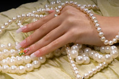 Hand in the pearl Royalty Free Stock Photography