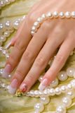 Hand in the pearl Royalty Free Stock Photos