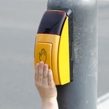 Hand on pedestrian crossing button Royalty Free Stock Images