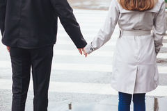 Hand at the pedestrian crossing. Love couple Stock Photo