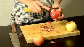 Hand peeling apple stock footage