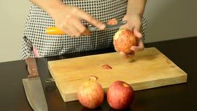 Hand peeling apple stock video