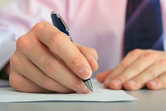 Hand with a pen. Stock Images