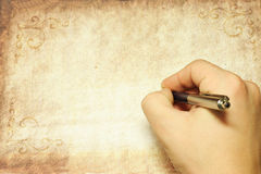 Hand and pen Royalty Free Stock Images