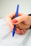Hand with pen Stock Images
