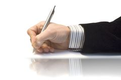 Hand with the pen Stock Photos