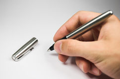 Hand with pen. Human hand with silver pen Stock Photos