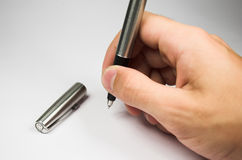 Hand with pen. Human hand with silver pen Royalty Free Stock Photography