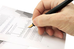 Hand with a pen Royalty Free Stock Images