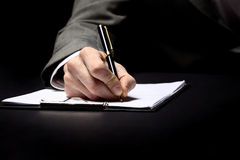Hand with pen Royalty Free Stock Image
