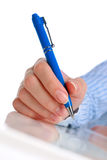 Hand with pen. Stock Images