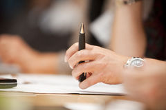 Hand with a pen Stock Images