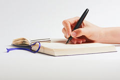 Hand with a pen. Hand with pen on white background Royalty Free Stock Photography