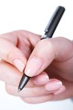 Hand with pen Stock Image