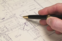 Hand with pen on a blueprint Royalty Free Stock Images
