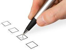 Hand with pen and check box Stock Images