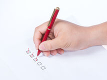 Hand with pen and check boxes Royalty Free Stock Images