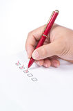 Hand with pen and check boxes Stock Images
