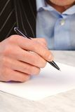 Hand with pen, color Royalty Free Stock Images