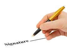 Hand with pen and contract Royalty Free Stock Photos
