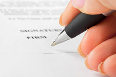 Hand with pen and contract Royalty Free Stock Image