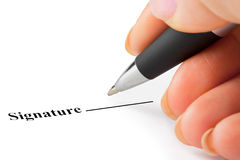 Hand with pen and contract Stock Image