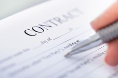 Hand With Pen On Contract Form Royalty Free Stock Photos