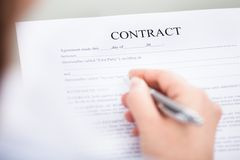 Hand With Pen On Contract Form Royalty Free Stock Photo