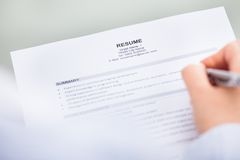 Hand with pen and curriculum vitae Stock Photos