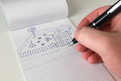 Hand with pen draw house. Man sketch new house for family royalty free stock photo